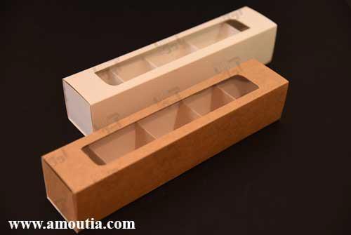 جعبه شکلات کاهی و سفید از نمای نزدیک