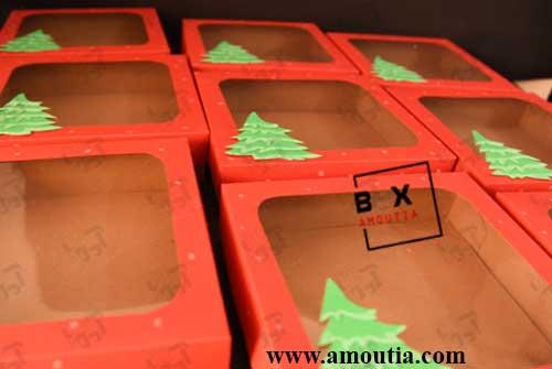عکس تعداد زیادی جعبه کریسمس در کنار هم